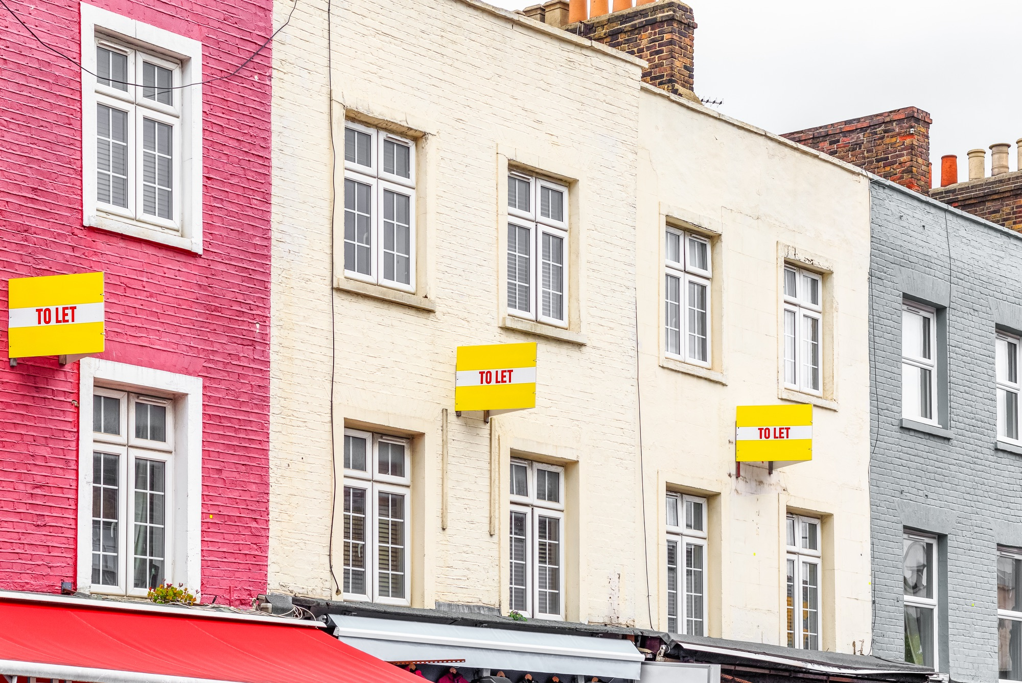 SS_Colourful terraced houses with TO LET signs around Camden Town in London