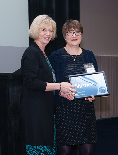 Pauline Clifford collects her Award