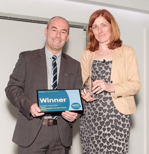 Helen Platts presents Exemplar Award to Tony Bracey - See more at: https://www.geoplace.co.uk/-/geoplace-announces-winners-of-2014-exemplar-awards#sthash.oGdzpCe3.dpuf